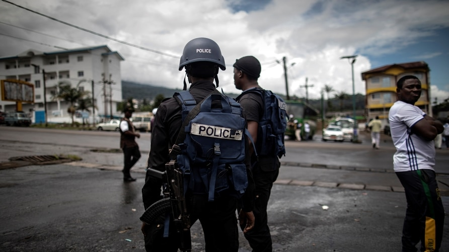 Cameroonian policemen patrol the market in the majority English-speaking  South West province in Buea, on October 3, 2018. -…