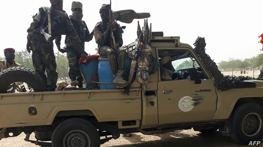 Soldiers of the Chad Army sit on the back of a Land Cruiser at the Koundoul market, 25 km from N'Djamena, on January 3, 2020,…