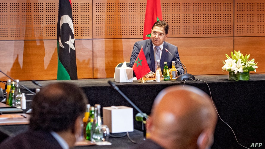 Nasser Bourita (C), Morocco's Minister of Foreign Affairs and International Cooperation, chairs a meeting of representatives of…