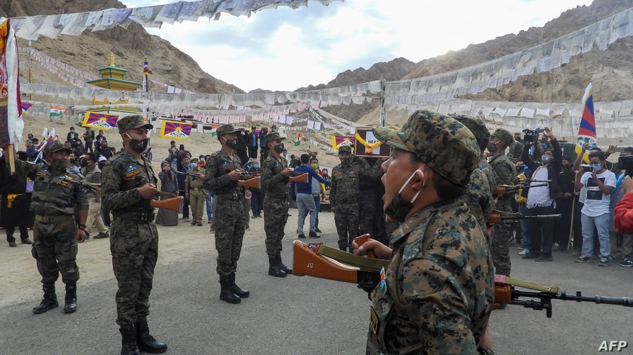 Indian soldiers pay their respects during the funeral of their comrade, Tibetan-origin India's special forces soldier Nyima…