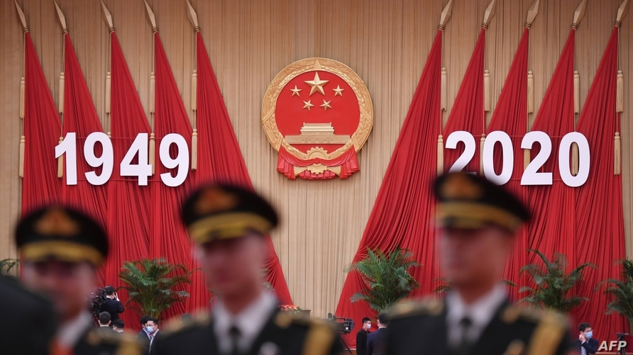 Members of a Chinese military band pose for photos before a reception at the Great Hall of the People in Beijing on the eve of…