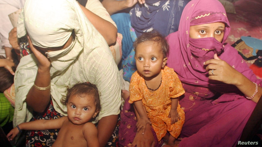 Pakistani female prisoners sit in a cell, along with their children, at Central Jail in Rawalpindi, near Islamabad, July 8, 2006