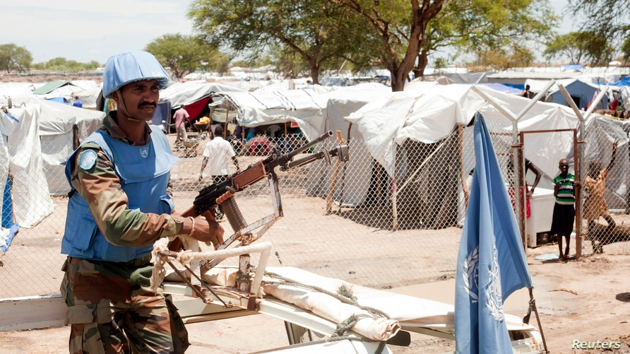 A United Nations peacekeeper keeps guard outside the Bor camp for the internally displaced in Bor town Jonglei state, South…