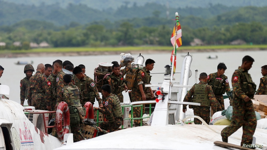 Myanmar soldiers arrive to Buthidaung jetty after Arakan Rohingya Salvation Army's (ARSA) attacks, at Buthidaung, Myanmar…
