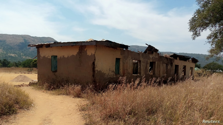 A primary school that was damaged during violence between farmers and herders is pictured in Kigam in southern Kaduna State,…