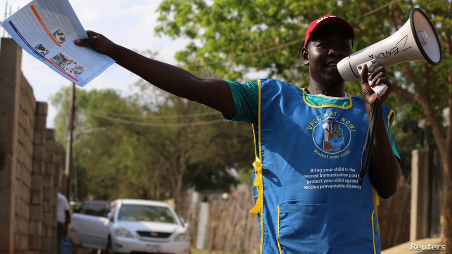 FILE - A South Sudanese health worker speaks on a megaphone during a campaign to vaccinate children against measles in Juba, South Sudan, Feb. 4, 2020.