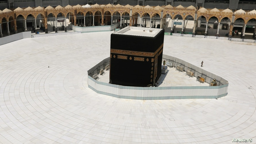 General view of Kaaba at the Grand Mosque which is almost empty of worshippers, after Saudi authority suspended umrah (Islamic…