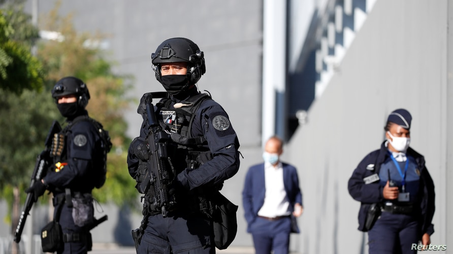 Police secure an entrance at the courthouse for the opening of the trial of the January 2015 Paris attacks against Charlie…