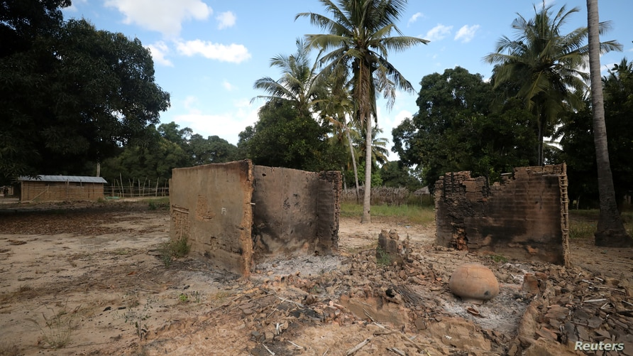FILE PHOTO: Burnt-out huts are seen at the scene of an armed attack in Chitolo village, Mozambique, July 10, 2018. Picture…