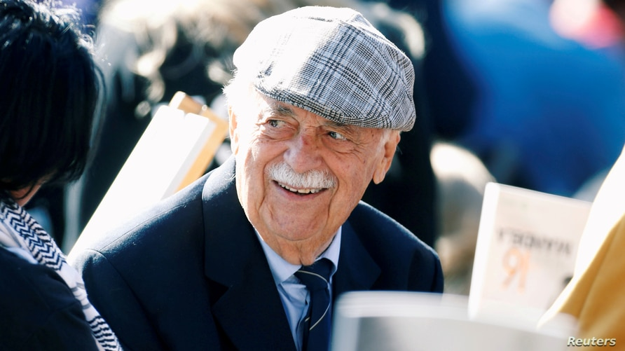 FILE PHOTO: Human rights lawyer George Bizos arrives to hear Former U.S. President Barack Obama delivering the 16th Nelson…
