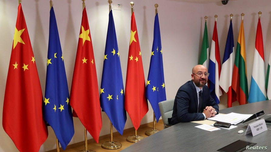 FILE PHOTO: European Council President Charles Michel takes part in a virtual summit with Chinese President Xi Jinping in…