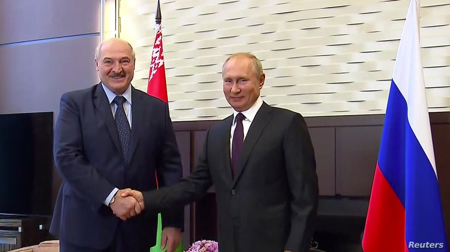 Russia's President Vladimir Putin shakes hands with his Belarusian counterpart Alexander Lukashenko during a meeting in Sochi,…