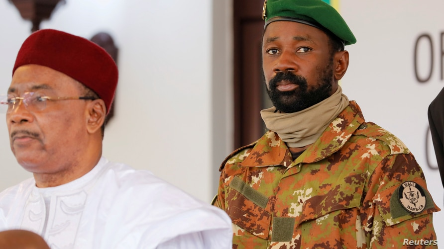 FILE PHOTO: Colonel Assimi Goita, leader of Malian military junta, looks on while he stands behind Niger's President Mahamadou…