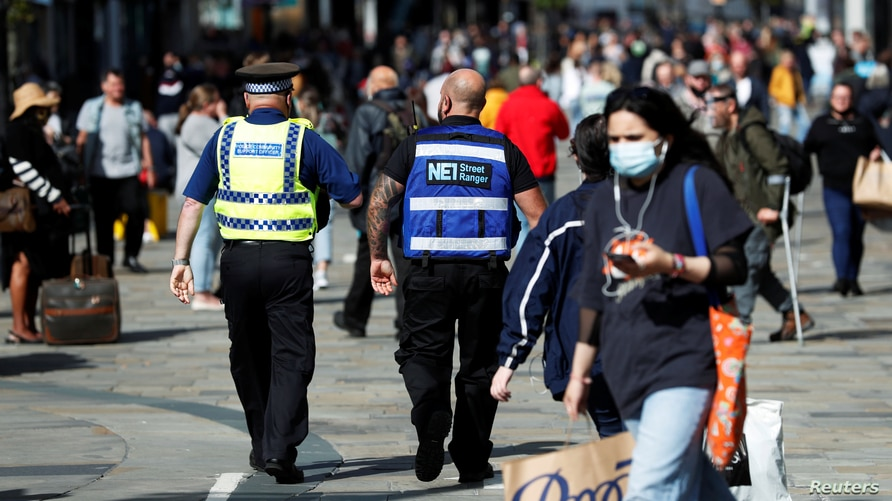 A street ranger and a police community support officer patrol Northumberland Street amid the spread of the coronavirus disease …