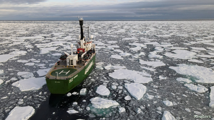 FILE PHOTO: Greenpeace's Arctic Sunrise ship navigates through floating ice in the Arctic Ocean, September 15, 2020. Picture…