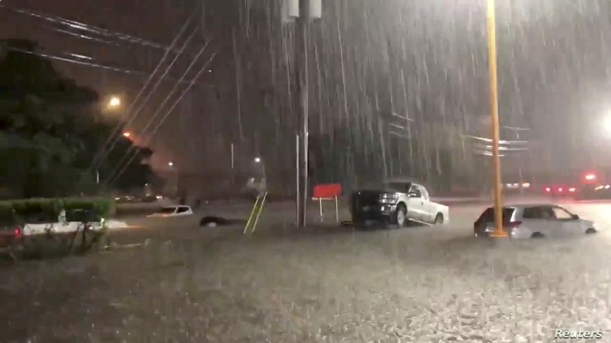 Vehicles are seen in an area affected by flood due to Tropical Storm Beta in Houston, Texas, September 21, 2020, in this still…