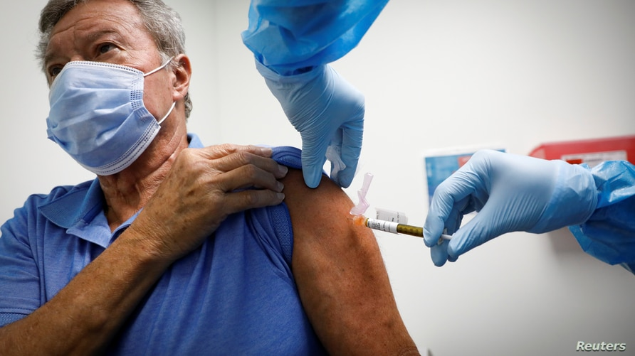 A volunteer is injected with a vaccine as he participates in a coronavirus disease (COVID-19) vaccination study