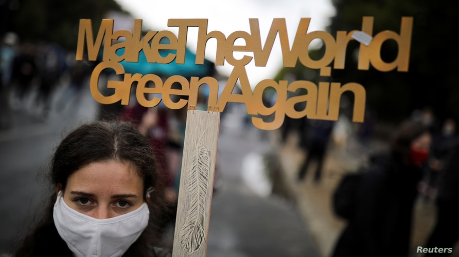 """A demonstrator holds a sign as Fridays for Future activists protest calling for a """"Global Day of Climate Action"""" in Berlin,…"""