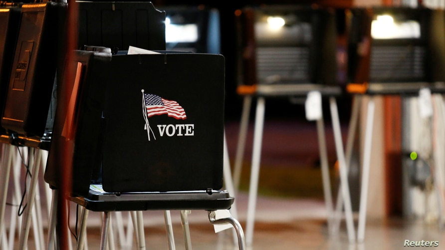 FILE PHOTO: A voting booth is seen at a polling center inside a fire station in the Coral Gables neighbourhood during the…
