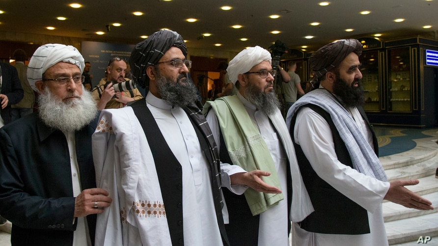 FILE - In this May 28, 2019 file photo, Mullah Abdul Ghani Baradar, the Taliban group's top political leader, second left,…