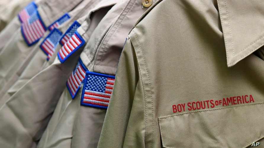 FILE - Boy Scouts of America uniforms are displayed in the retail store at the headquarters for the French Creek Council of the Boy Scouts of America in Summit Township, Pa, Feb. 18, 2020.