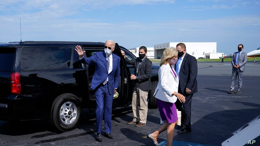 Democratic presidential candidate former Vice President Joe Biden, and his wife Jill Biden walk to board a plane.