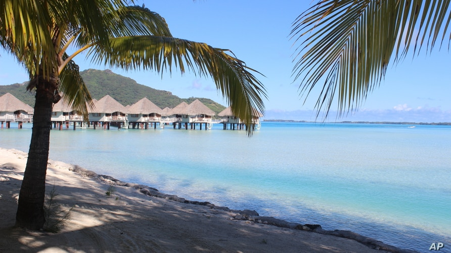FILE - A view of the beach, lagoon and bungalows at Le Meridien resort in Bora Bora.