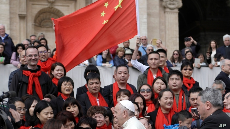 Pope Francis meets a group of faithful from China at the end of his weekly general audience in St. Peter's Square, at the…