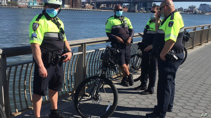 FILE - Police Officers patrol East River Park during the Coronavirus Pandemic in New York City, May 2, 2020.