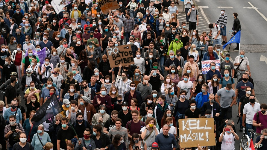 Demonstrators protesting against the dismissal of the editor-in-chief of the Hungarian news website Index.hu march in the streets of Budapest, Hungary, Friday, July 24, 2020.