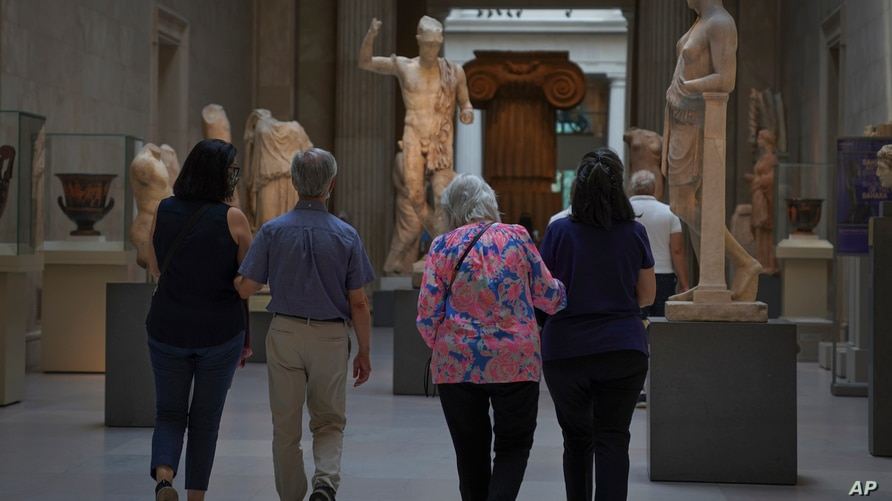 Visitors tour The Metropolitan Museum of Art during a preview in advance of its reopening next Saturday, Thursday Aug. 27, 2020…