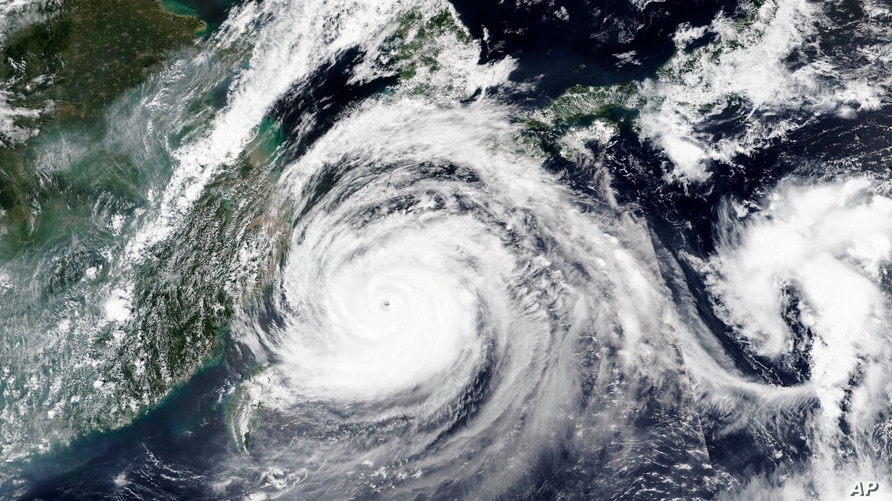 This Tuesday, Sept. 1, 2020, satellite image released by NASA shows Typhoon Maysak over Japan's southernmost islands, including…