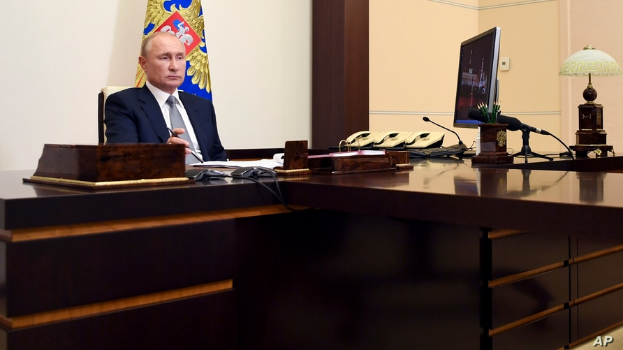 Russian President Vladimir Putin attends a meeting via video conference at the Novo-Ogaryovo residence outside Moscow, Russia, Sept. 3, 2020.