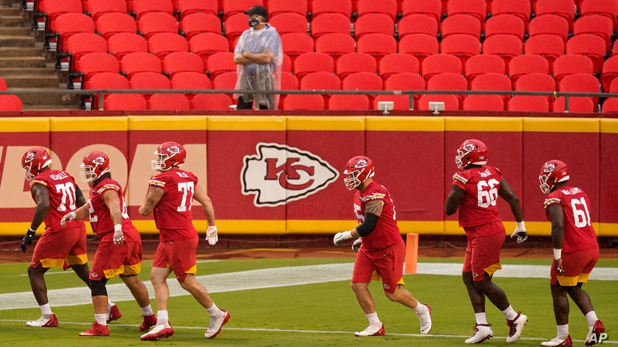 FILE - In this Aug. 29, 2020, file photo, Kansas City Chiefs players run during NFL football training camp at Arrowhead Stadium…