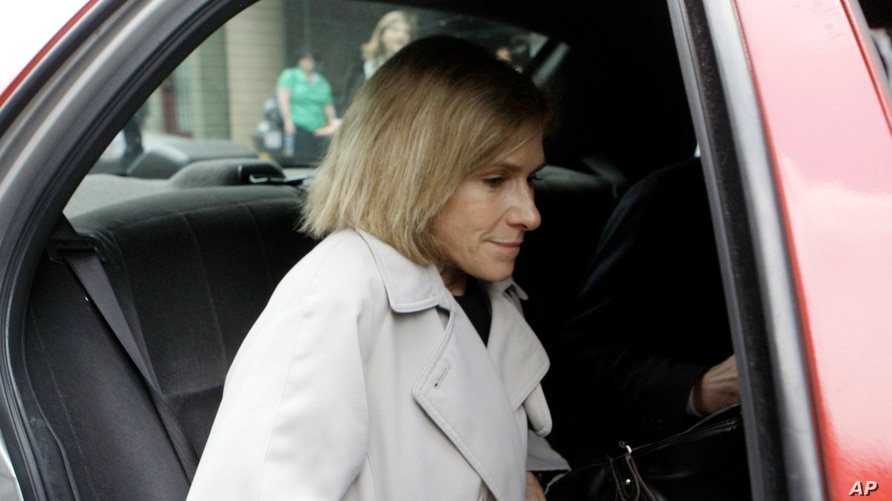 FILE - In this May 15, 2009, then-acting U.S. Attorney Nora Dannehy leaves law offices in Washington. Dannehy, a federal…