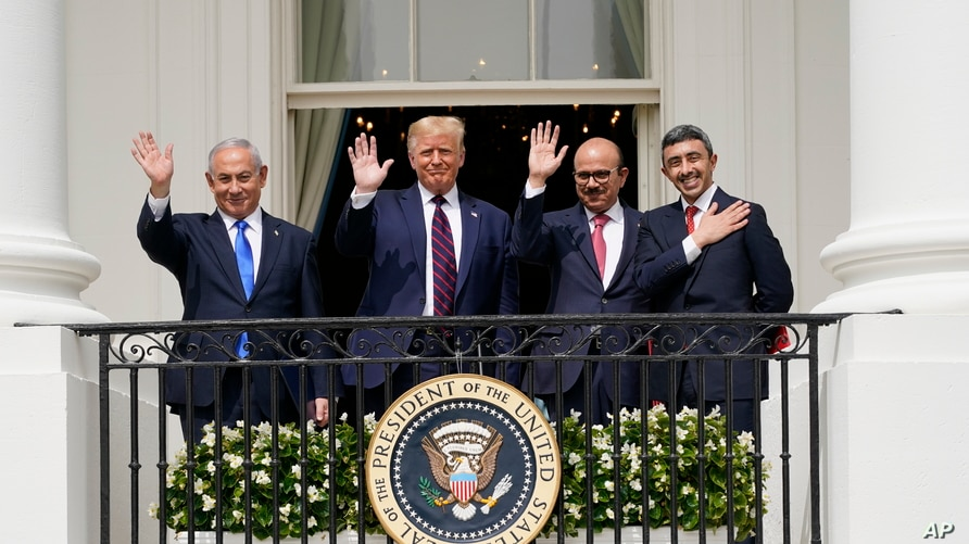 Israeli Prime Minister Benjamin Netanyahu, left, President Donald Trump, Bahrain Foreign Minister Khalid bin Ahmed Al Khalifa and United Arab Emirates Foreign Minister Abdullah bin Zayed al-Nahyan react on the Blue Room Balcony after signing the Abraham Accords during a ceremony on the South Lawn of the White House, Tuesday, Sept. 15, 2020, in Washington.