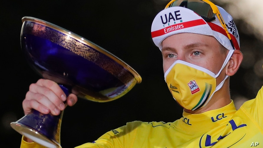 Tour de France winner Slovenia's Tadej Pogacar, wearing the overall leader's yellow jersey, celebrates on the podium after the twenty-first and last stage of the Tour de France cycling race over 122 km, from Mantes-la-Jolie to Paris, Sept. 20, 2020.