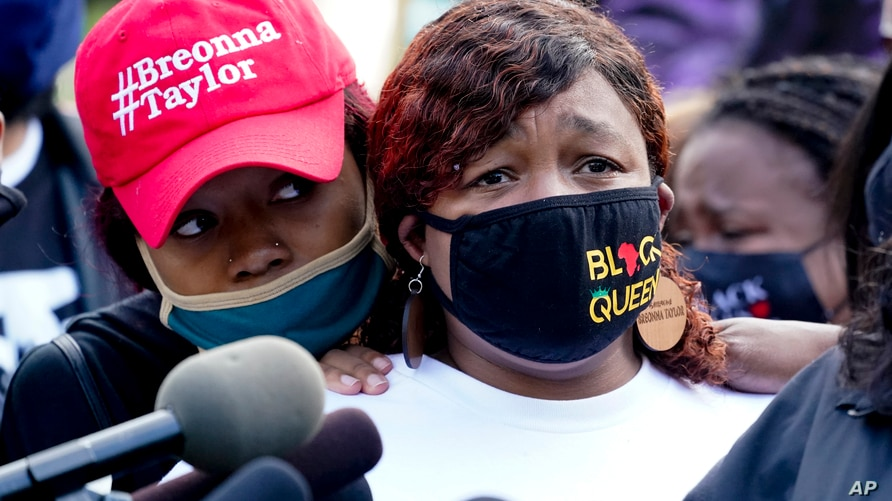 Tamika Palmer, the mother of Breonna Taylor, right, listens to a news conference, Friday, Sept. 25, 2020, in Louisville, Ky…