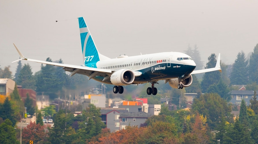 A Boeing 737 MAX lands at Boeing Field in Seattle on Wednesday, Sept. 30, 2020.  FAA chief Steve Dickson, a pilot who flew for…