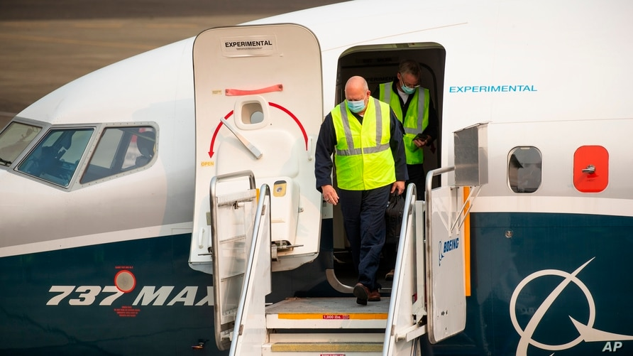 FAA chief Steve Dickson walks out of a Boeing 737 MAX, after concluding a test flight and landing at Boeing Field in Seattle,…