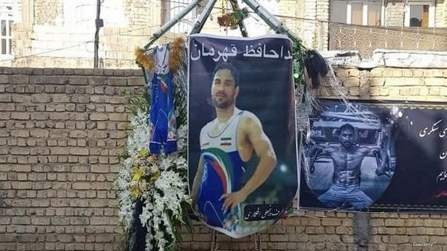 In this image shared widely online, tributes are displayed outside the home of Iranian wrestler Navid Afkari in the city of Shiraz, after Iran executed him on September 12, 2020 for a murder confession that he said was obtained under torture.