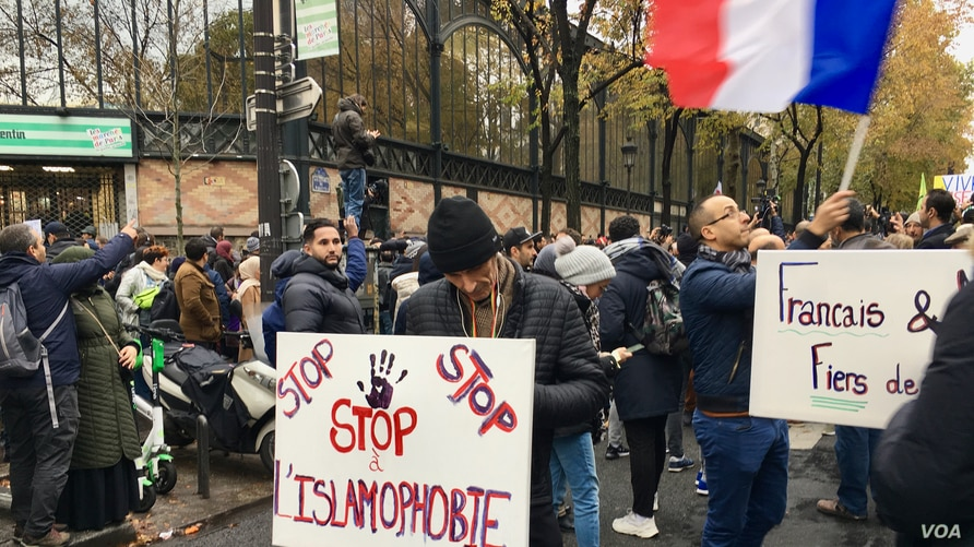 FILE - Protesters are seen at a march against Islamophobia in Paris, France, Nov. 2019. (Lisa Bryant/VOA)