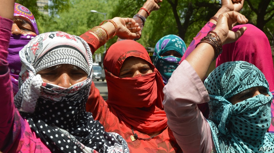 FILE - Villagers shout slogans during a protest in New Delhi, India, April 22, 2014, against the rape of a lower caste Dalit in Haryana state.
