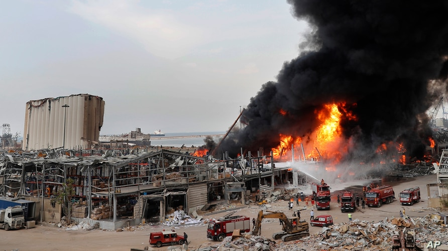 Firefighters work to extinguish a blaze at warehouses at the seaport in Beirut, Lebanon, Sept. 10, 2020.