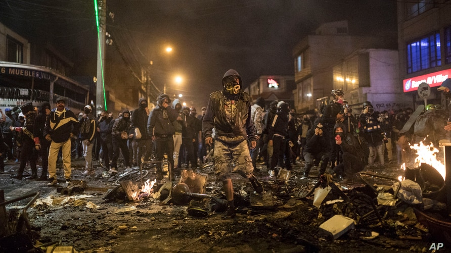 Demonstrators face off with police during protests sparked by the death of a man in police custody, in the Villa Luz neighborhood of Bogota, Colombia, Sept. 9, 2020.