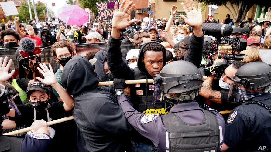 Police and protesters converge during a demonstration after a decision by a grand jury in the police shooting death of Breonna Taylor, in Louisville, Kentucky, Sept. 23, 2020.