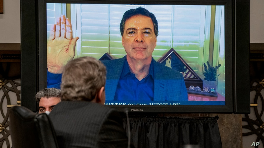 Former FBI director James Comey is sworn via videoconference before testifying during a Senate Judiciary Committee hearing on Capitol Hill in Washington, Sept. 30, 2020.
