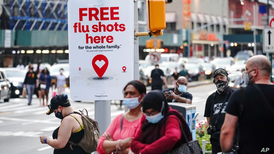 FILE - An ad offering free flu shots is seen in Brooklyn, New York, Aug. 21, 2020.