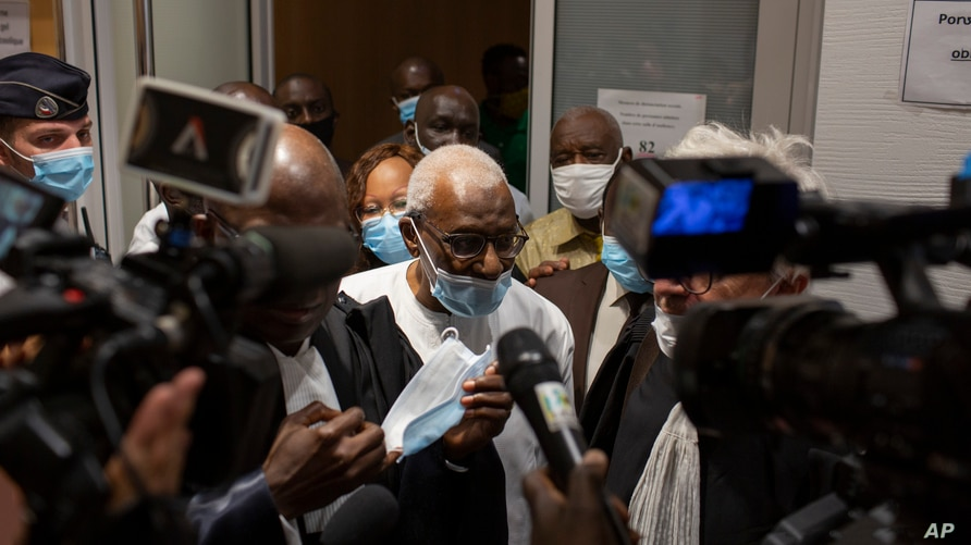 Former World Athletics chief Lamine Diack leaves the courtroom after his trial in Paris, France, Sept. 16, 2020.
