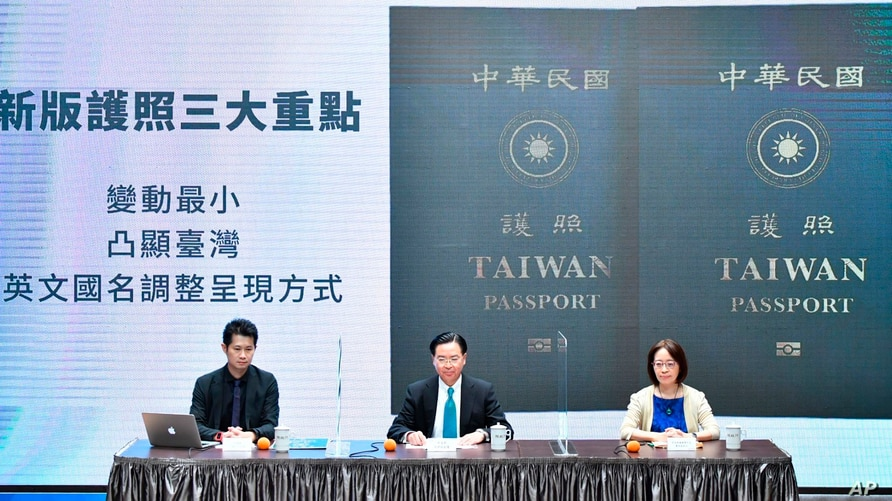 In this Sept. 2, 2020, photo released by the Executive Yuan, Taiwan's Foreign Minister Joseph Wu (C) and Executive Yuan spokesperson Evian Ting (L), and Director of Consular Affairs Bureau Phoebe Yeh unveil Taiwan's new passport cover in Taipei.